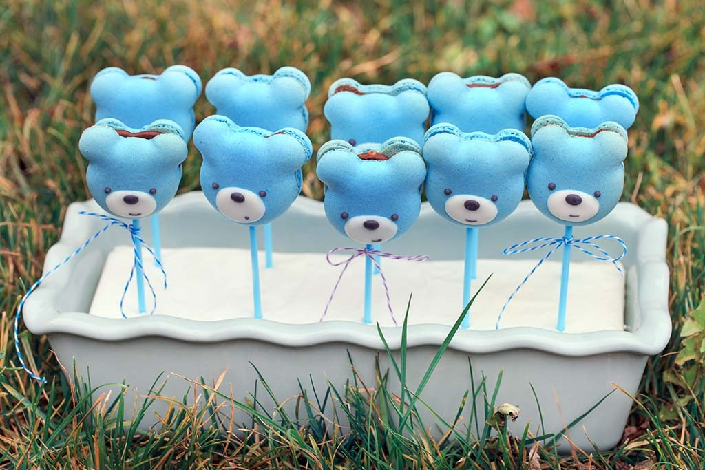 teddy bears shaped macarons on grass background
