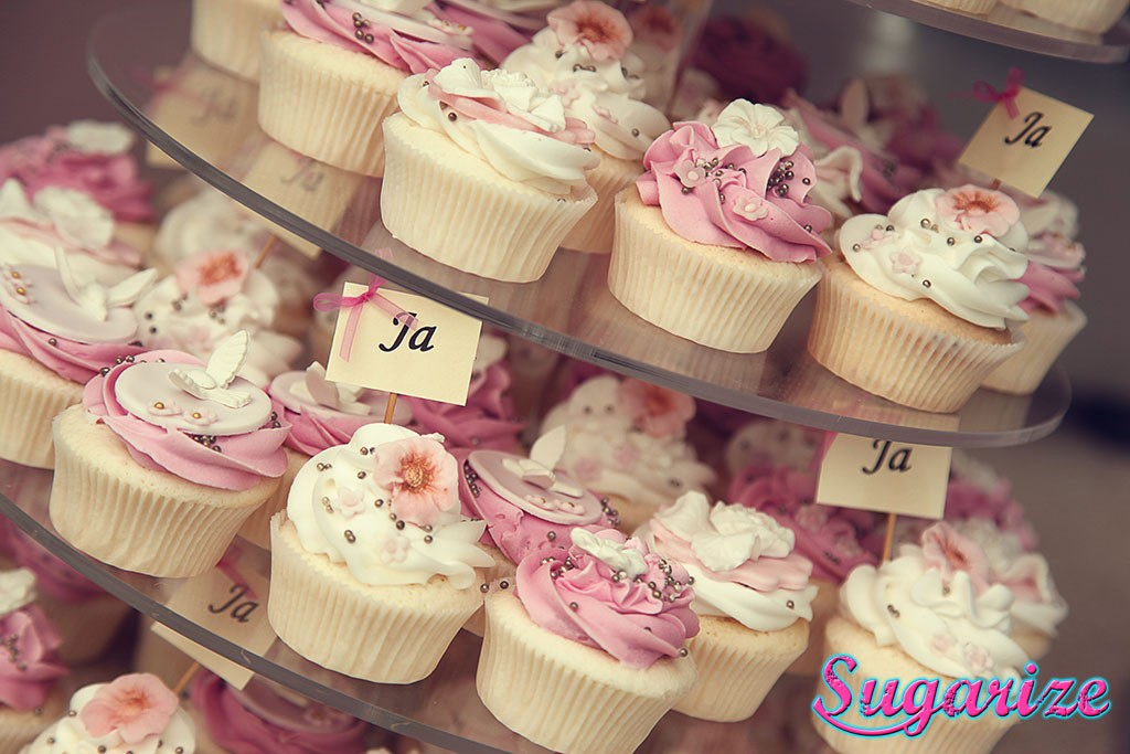 Wedding cupcakes on a glass plate